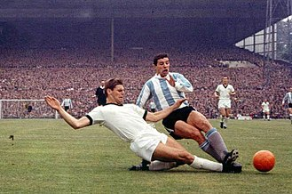 1966 FIFA World Cup - Wolfgang Weber (left) and Luis Artime during the match between West Germany and Argentina in Birmingham