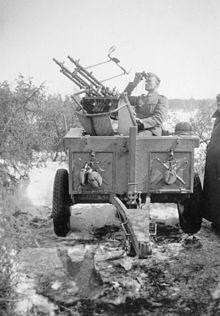 19b21b44a German soldier manning a MG34 anti-aircraft gun in WW2
