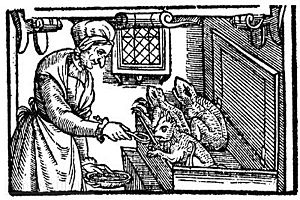 Familiar spirit - A late 16th-century English illustration of a witch feeding her familiars.