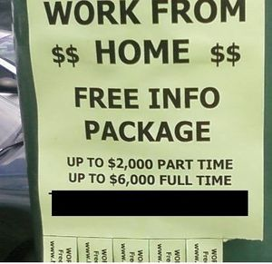 Work-at-home scheme - An ad for a work-at-home scheme posted on a pole