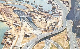 Kellett Island - Entrance of the Cross-Harbour Tunnel and land reclamation connecting Kellett Island (upper left) to Causeway Bay in the 1970s.