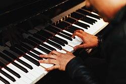 Yamaha piano player (Unsplash).jpg