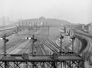 South Station - Looking north at the merge of the two approaches, with the two pairs of tracks approaching the lower-level loop at right; the terminal is in the background. (c. 1904)