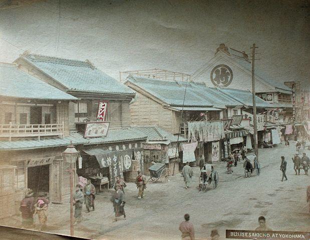 Hand colored albumen photograph of Isezaki-chō street scene, Yokohama, Japan (circa 1880)