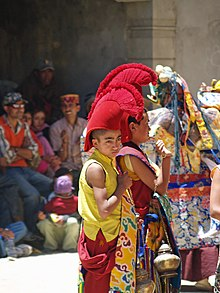 Young buddhist monk in ceremonial headwear.jpg