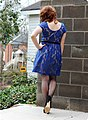 Young woman in flesh lined blue lace dress with seamed stockings.jpg