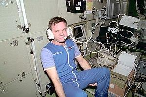 Yuri Gidzenko - Gidzenko on board the Zvezda Service Module of the ISS communicates with ground controllers.