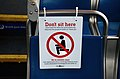 """Don't sit here"" sign on a seat in a TriMet bus for social distancing during COVID-19 pandemic.jpg"