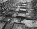 """""""View east looking down on portion of concreted area from trestle at Westmix plant."""" - NARA - 294186.tif"""