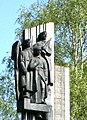 Святая троица бойцов в навершии стелы Памяти Погибших истоковцев.jpg