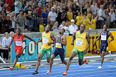 Usain Bolt setting a world record in the 100m dash at the 2009 World Championships in Athletics in Berlin. 100 m final Berlin 2009.JPG