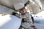 144th FW airmen go above and beyond 120205-F-VM449-044.jpg