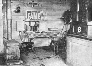 Traveling library - Library box set up in a shop, Wisconsin, USA, 1890s