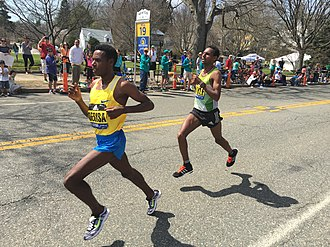 2016 Boston Marathon - Second place Lelisa Desisa leads eventual winner Lemi Berhanu Hayle at mile 19