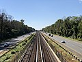 2018-10-23 13 16 06 View west along Interstate 66 and the Orange Line of the Washington Metro from the overpass for Barbour Road (Virginia State Route 2793) in Idylwood, Fairfax County, Virginia.jpg