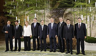 "34th G8 summit - G8 ""family photo"" at the Hokkaido summit.  From left are: Prime Minister Silvio Berlusconi of Italy; President Dmitry Medvedev of Russia; Chancellor Angela Merkel of Germany; Prime Minister Gordon Brown of the United Kingdom; Prime Minister Yasuo Fukuda of Japan; President George W. Bush of the United States; Prime Minister Stephen Harper of Canada; President Nicolas Sarkozy of France, and José Manuel Barroso, President of the European Commission"