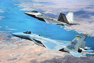 433d Weapons Squadron - 433d WPS F-22A Raptor and F-15C Eagle from the U.S. Air Force Weapons School's 433rd Weapons Squadron fly in formation over Lake Mead, Nev., on 16 July 2010.