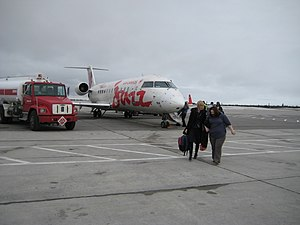 Jazz Aviation destinations - Passengers walking towards the terminal after arriving in Happy Valley Goose Bay, one of the destinations of Air Canada Express