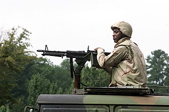 Personnel Armor System for Ground Troops - A U.S. airman in September 2001 wearing a PASGT helmet and vest with desert camouflage covers.