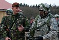 A Romanian soldier, left, with the 1 (German-Netherlands) Corps speaks with a U.S. Soldier assigned to the 2nd Cavalry Regiment during a mission rehearsal exercise at the Joint Multinational Readiness Center 130310-A-WZ615-004.jpg