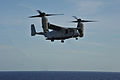 A U.S. Marine Corps MV-22B Osprey tiltrotor aircraft prepares to land on the flight deck of the amphibious assault ship USS Bataan (LHD 5), not shown, Dec. 10, 2013, in the Atlantic Ocean 131210-N-JX484-021.jpg