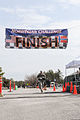 A U.S. Soldier participating in the Maryland Army National Guard's March Against Hunger crosses the finish line in La Plata, Md., March 16, 2013 130316-A-ZZ999-070.jpg