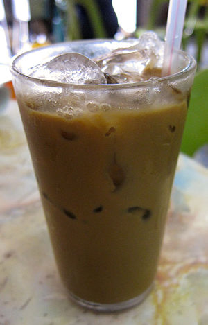 Ipoh white coffee - A glass of Ipoh iced white coffee.
