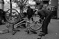 A man repairs a bike.jpg