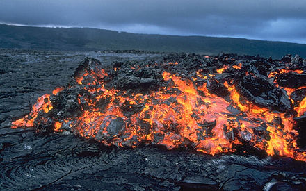 Glowing `a`a flow front advancing over pahoehoe on the coastal plain of Kilauea in Hawaii, United States Aa large.jpg
