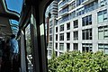 Aboard Seattle Center Monorail, apartment buildings on the east side of 5th Avenue visible.jpg