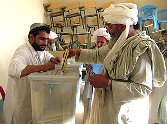 Afghan parliamentary election, 2005 - An Afghan man casting his ballot at a polling station at Lashkar Gah, which is the capital of Helmand province.