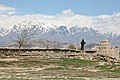 Afghan police officer standing on wall while on security duty near Bagram 140416-A-IY570-041.jpg