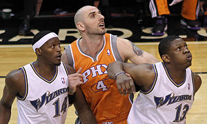Marcin Gortat - Gortat battling for a rebound during his tenure with the Suns