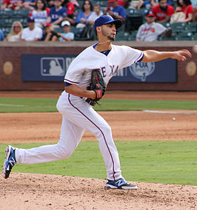 Alex Claudio pitching in Arlington in Sept 2014.jpg