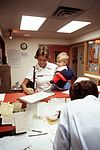 An Air Force nurse checks her child in at the Kitty Hawk child-care center DF-ST-82-10394.jpg
