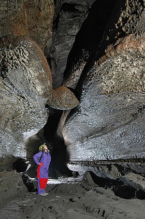 "Ape Cave - A famous feature far into the cave is the ""Meatball"". It is a lava ball wedged in a ceiling channel. Lava balls form from smaller rocks which roll along in lava flows, accreting more and more layers over time, like a snowball rolling down a snow bank."