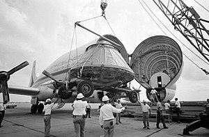 Aero Spacelines Super Guppy - The Apollo 11 Command Module (CM) is loaded aboard a Super Guppy at Ellington AFB for shipment to North American Rockwell Corporation at Downey, California.