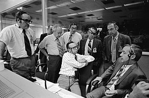 Dale D. Myers - Myers, center-right, during a meeting to discuss whether Apollo 16 should land on the moon (1972)