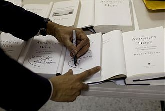 The Audacity of Hope - Obama signs copies of  The Audacity of Hope at a town hall meeting in Elkhart, Indiana on economic recovery in February 2009.