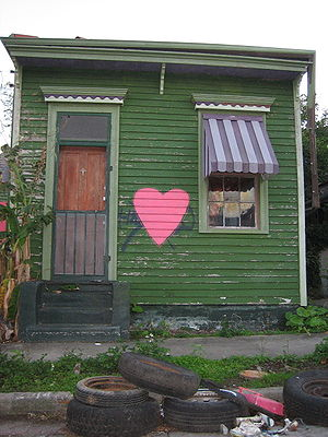 Shotgun house - A modest shotgun house in New Orleans's Bayou St. John neighborhood shortly after Hurricane Katrina. Shotgun houses consist of three to five rooms in a row with no hallways and have a narrow, rectangular structure.