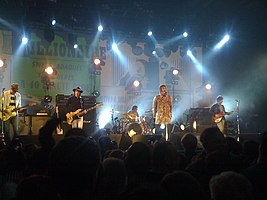 Beady Eye onstage performing Millionare