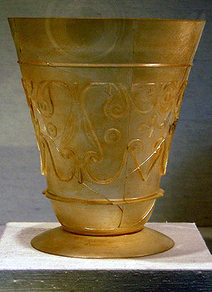 Beaker (archaeology) - 9-10th century beaker from Iran. Blown and relief-cut glass. New York Metropolitan Museum of Art.