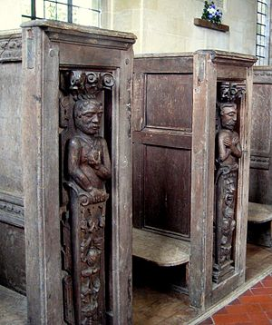 Pew - Jacobean bench end carvings in St Kenelm's Church, Sapperton, Gloucestershire, England