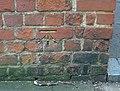 Benchmark cut in brick of Forbury gateway. - geograph.org.uk - 701905.jpg