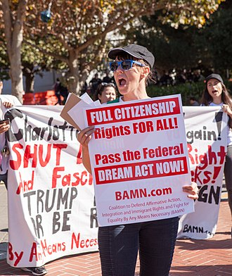 """BAMN - A protester at a September 2017 demonstration in Berkeley holds a BAMN sign reading """"Full Citizenship Rights For All! Pass the Federal Dream Act Now!"""""""