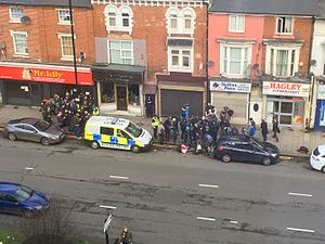 2017 Westminster attack - Police and media outside the Hagley Road premises that were raided on 22 March, seen on the morning following the raid