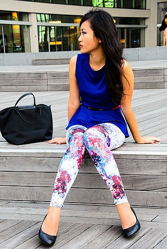 Leggings - A woman wearing white leggings with a floral design