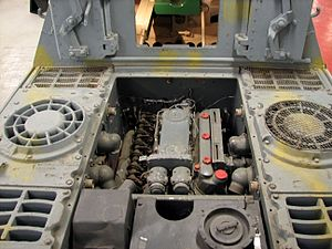 Jagdtiger - Rear deck and engine bay of Jagdtiger 305004, The Tank Museum, Bovington, 2009. The two circular grilled apertures at left and right are for the  radiator horizontal cooling fans.