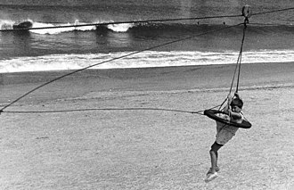 Breeches buoy - a child riding a breeches buoy
