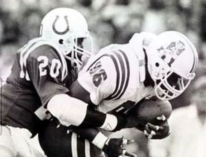 Albert Bentley - Bentley (left) tackling an opponent for the Colts in 1988
